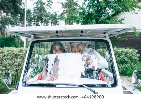 Bride and groom driving a golf cart