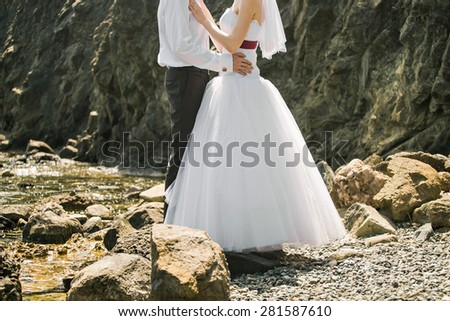 bride and groom embracing - stock photo