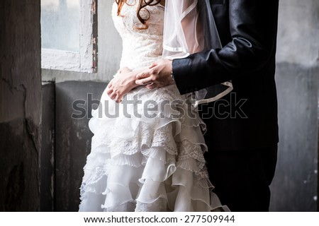 Bride and groom embracing, Dancing bride and groom - stock photo