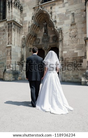 Bride and groom entering the church. Concept for marriage made by God to unite only a man and a woman in a single body. - stock photo