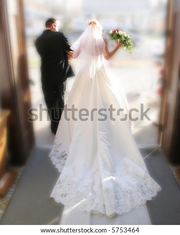 Bride and groom exiting church after being wed. - stock photo