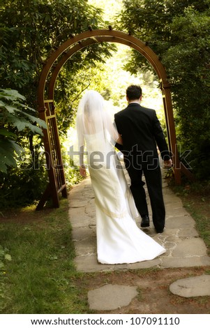 Bride and Groom Exiting the Wedding Ceremony - stock photo