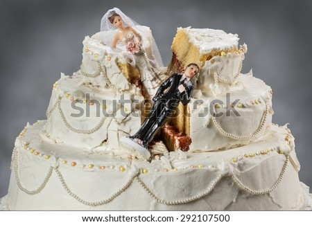 Bride and groom figurines collapsed at ruined wedding cake  Spouses always seem to struggle to keep their relationship alive - stock photo
