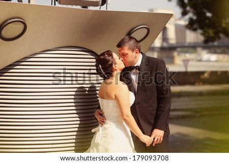 Bride and groom gazing  - stock photo