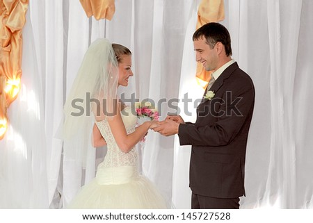 Bride and groom getting married In  ceremony  - stock photo