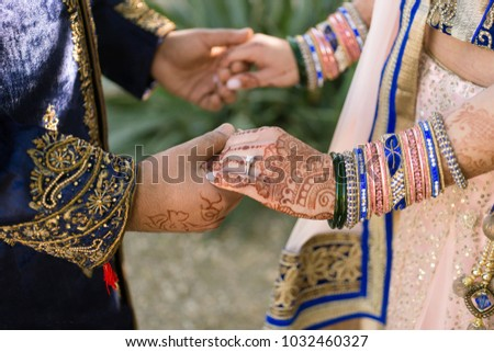 Bride and groom hands holding bridal showing wedding Jewelry Ring & Bangles (Pakistani-Indian)
