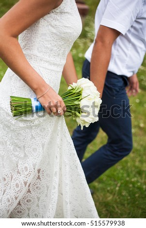 bride and groom holding a beautiful wedding bouquet