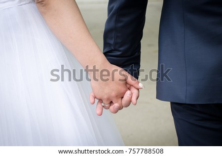 bride and groom holding hands at the wedding