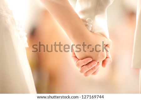 Bride and groom  holding hands in wedding celemony - stock photo