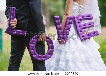 Bride and groom holding the letter the word love word love composed of letters handmade Sew Fabric word love - stock photo