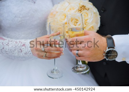 Bride and groom holding wedding champagne glasses hands of bride and groom with glasses of champagne