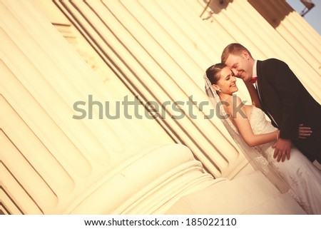 Bride and groom in a architectural place - stock photo