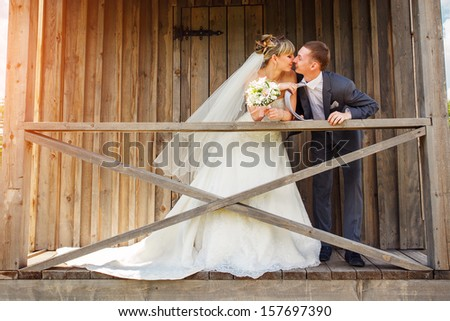 Bride and groom in a park  - stock photo