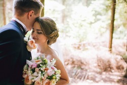 Free wedding stock photos bride and groom in a park kissinguple newlyweds bride and groom at a wedding junglespirit Images
