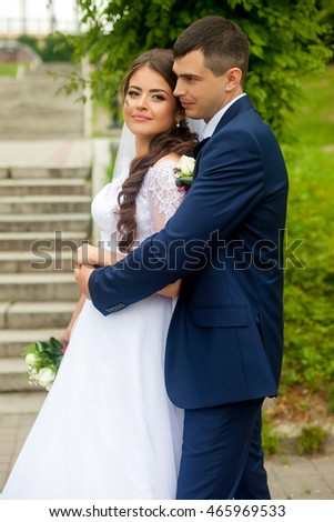 bride and groom in a park on the nature