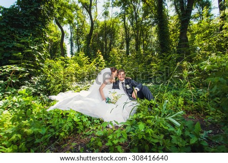 Bride and groom in amazing summer green forest