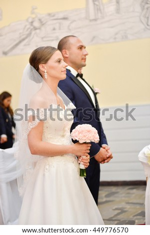 bride and groom in church during in the ceremony