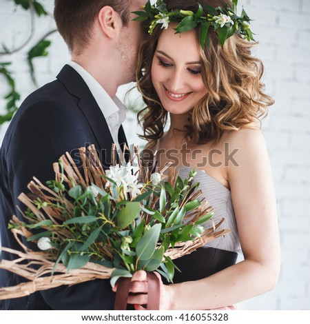 Bride and groom in elegant grey and green style over ecological natural decoration