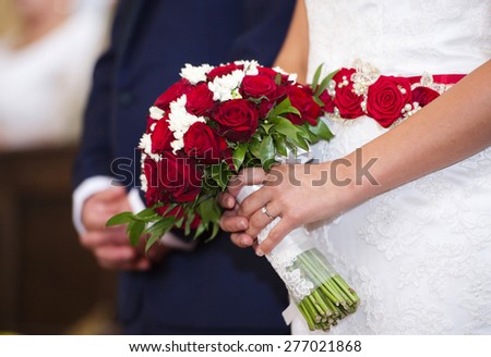 Bride and groom in the church holding hands