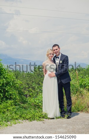 bride and groom in the garden, wedding day - stock photo