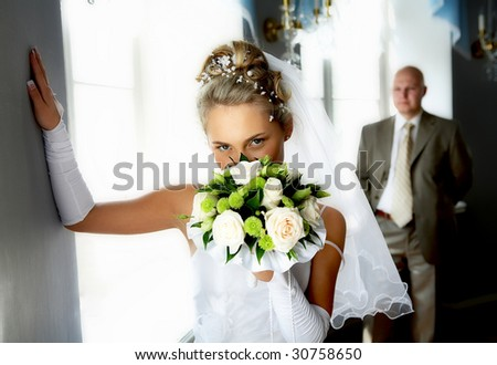 bride and groom in the hall - stock photo