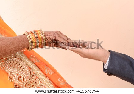 stock-photo-bride-and-groom-joining-hand