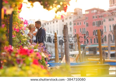 bride and groom kissing in Venice - stock photo