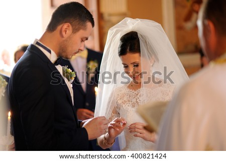 Bride and groom leaving the church during the wedding ceremony - stock photo