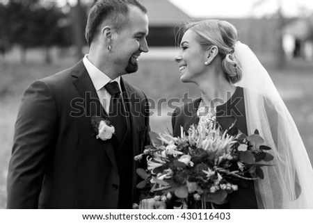 Bride and groom look awesome smiling on the field