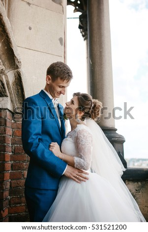 Bride and groom look into each others eyes on a wedding day