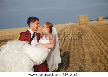bride and groom looking at each other and being in love - stock photo