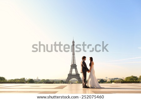 Bride and groom near Eiffel tower - stock photo