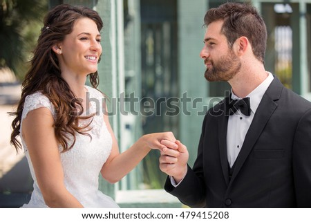 Bride and groom newlywed couple lifestyle outdoor destination wedding park holding hands