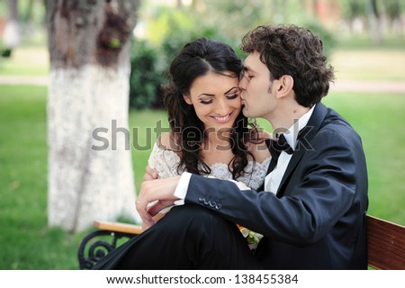 Bride and groom on a romantic moment in their wedding day