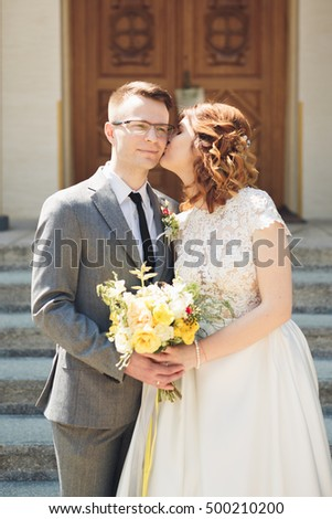 Bride and groom on the background of beautiful church.  old building. Arch. Wedding