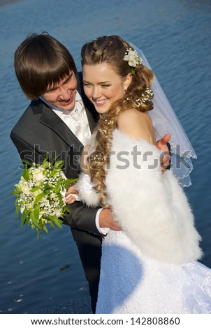 Bride and groom on the background of the river
