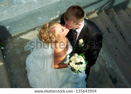 Bride and groom on the background of the stairs
