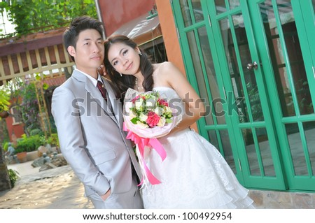 Bride and groom on their wedding day ,asian lover - stock photo