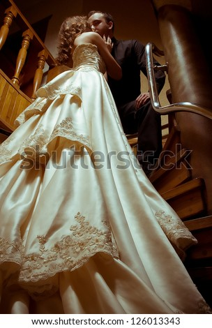 Bride and groom on their wedding day in a luxurious restaurant.