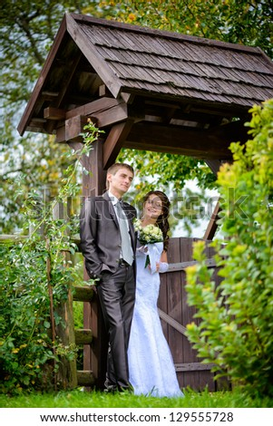 Bride and groom outdoor portrait - stock photo