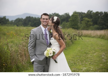 Bride and Groom Outside on their Wedding Day - stock photo