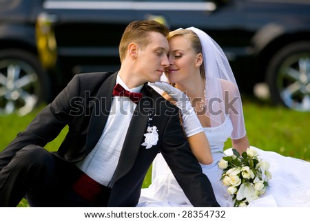 bride and groom over wedding car background - stock photo