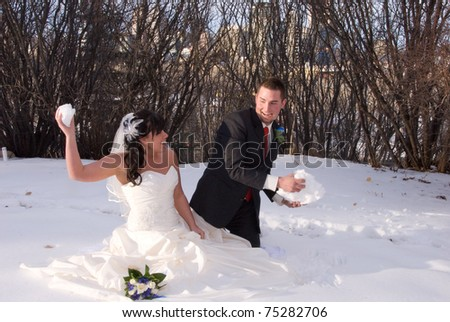 Bride and Groom Playing Snow Fight