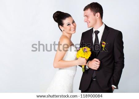 Bride and groom portrait in studio - stock photo