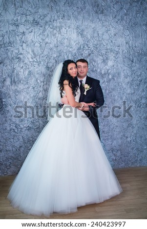 Bride and groom posing in the studio together