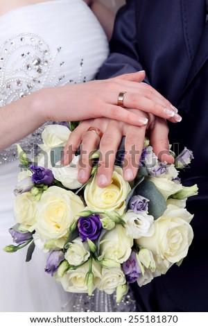 Bride and Groom's hands. Wedding bouquet. - stock photo