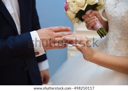 Bride and groom's hands with wedding gold rings
