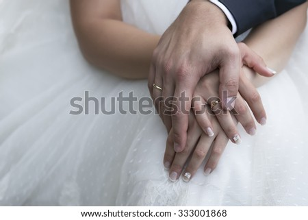 Bride and groom's hands with wedding rings (soft focus) .Cross processed image for vignette blur look