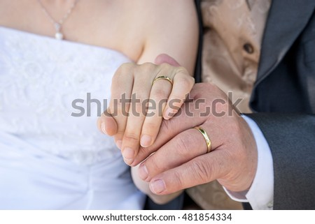 Bride and groom showing their wedding rings / Engagement rings / Wedding