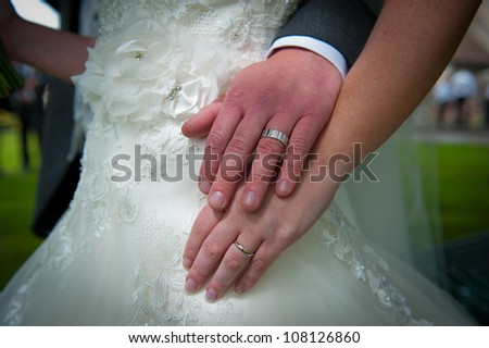 Bride and Groom showing wedding rings - stock photo